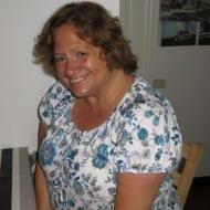 Mamma happy sitting in my Genoa kitchen